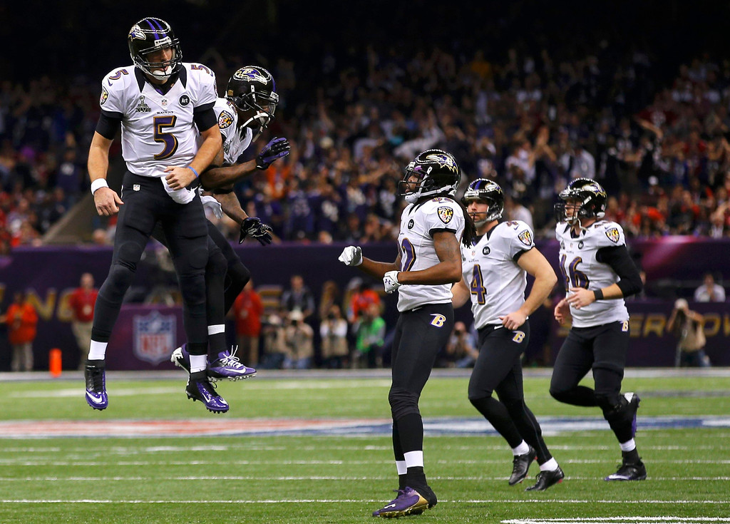 Description of . Baltimore Ravens quarterback Joe Flacco (5) celebrates with his teammates after his second touchdown pass of the game against the San Francisco 49ers during the second quarter of the NFL Super Bowl XLVII football game in New Orleans, Louisiana, February 3, 2013. REUTERS/Brian Snyder