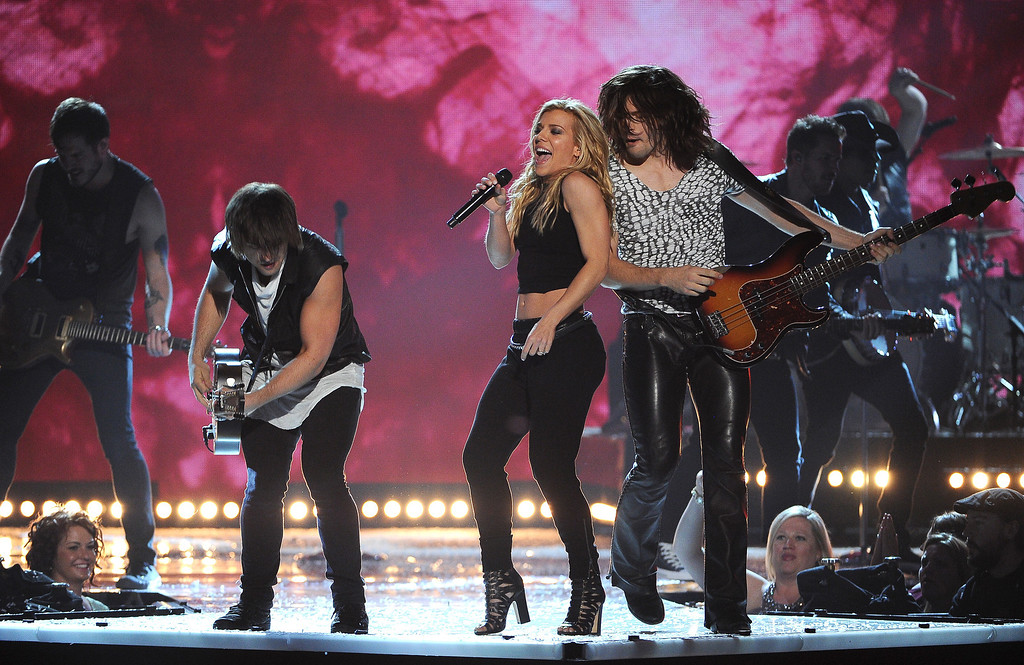 Description of . Neil Perry, from foreground left, Kimberly Perry and Reid Perry, of the musical group The Band Perry, perform at the 49th annual Academy of Country Music Awards at the MGM Grand Garden Arena on Sunday, April 6, 2014, in Las Vegas. (Photo by Chris Pizzello/Invision/AP)