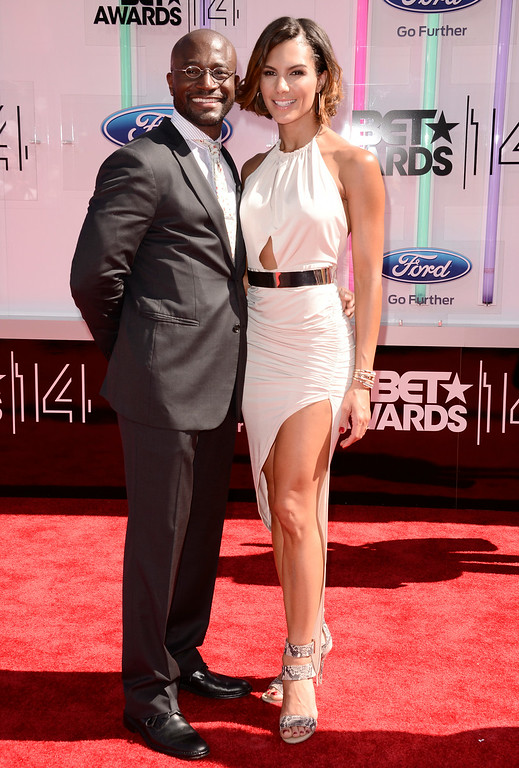 Description of . Taye Diggs, left, and Amanza Smith Brown arrive at the BET Awards at the Nokia Theatre on Sunday, June 29, 2014, in Los Angeles. (Photo by Dan Steinberg/Invision/AP)