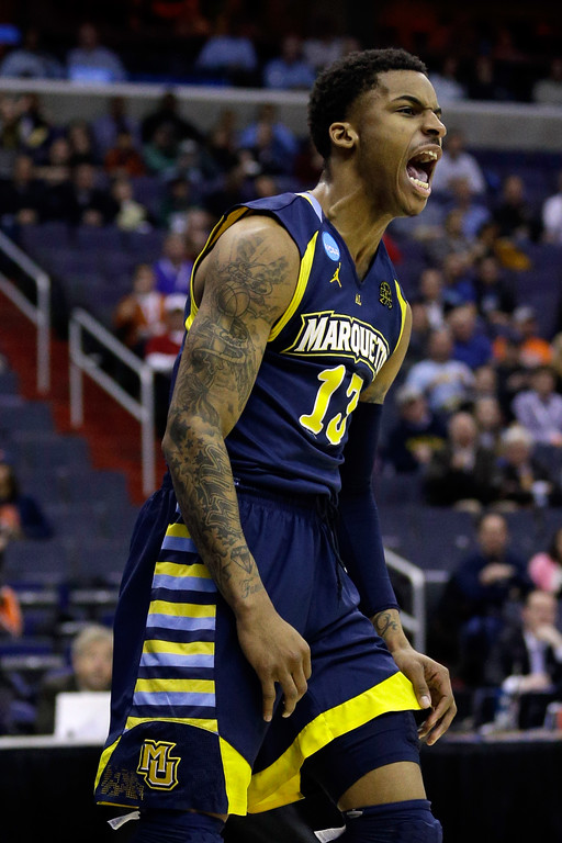 Description of . WASHINGTON, DC - MARCH 28:  Vander Blue #13 of the Marquette Golden Eagles reacts after a dunk against the Miami (Fl) Hurricanes during the East Regional Round of the 2013 NCAA Men's Basketball Tournament at Verizon Center on March 28, 2013 in Washington, DC.  (Photo by Rob Carr/Getty Images)