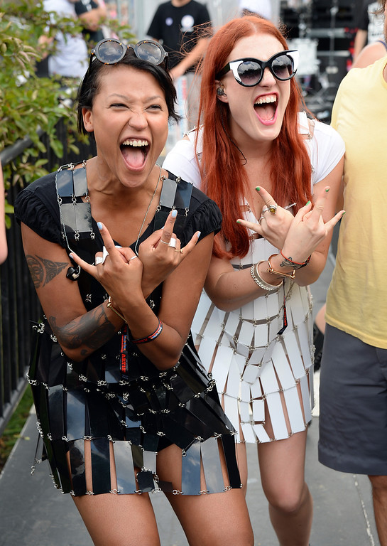 Description of . CHICAGO, IL - AUGUST 02:  Aino Jawo and Caroline Hjelt of Icona Pop pose backstage during Lollapalooza 2013 at Grant Park on August 2, 2013 in Chicago, Illinois.  (Photo by Theo Wargo/Getty Images)