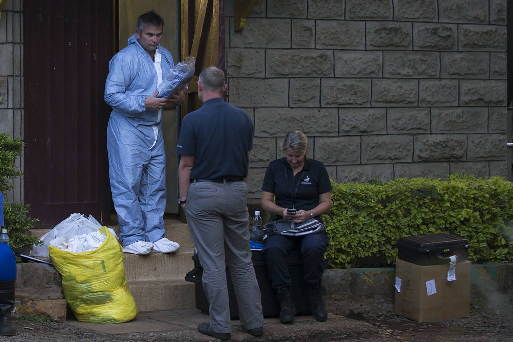 Description of . An International forensic team outside the city mortuary on September 26, 2013 in Nairobi, Kenya.  (Photo by Uriel Sinai/Getty Images)