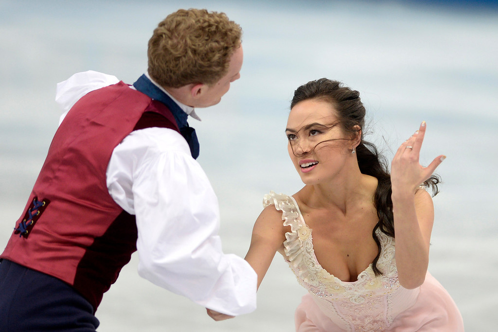 Description of . American skaters Evan Bates and Madison Chock perform during the figure skating ice dancing free dance medal round. Sochi 2014 Winter Olympics on Monday, February 17, 2014. (Photo by AAron Ontiveroz/The Denver Post)