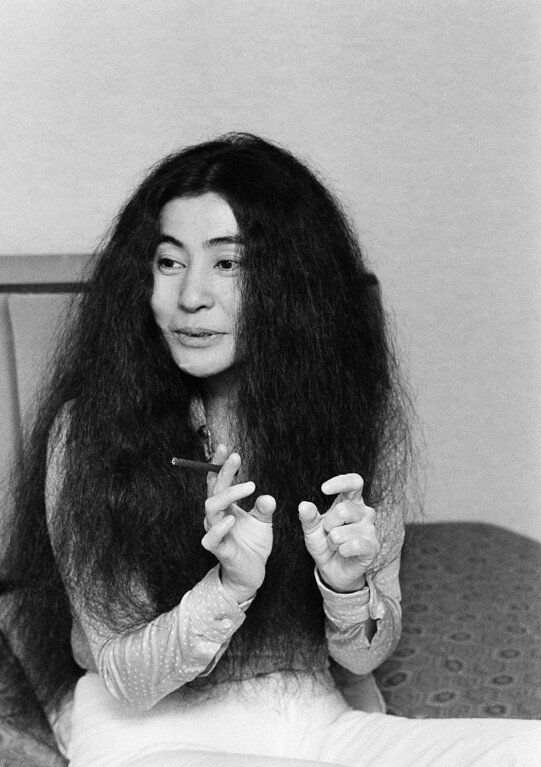 Description of . Yoko Ono is shown during an interview with AP reporter Kathryn Tolbert at a Tokyo Hotel, Wednesday, August 14, 1974, Tokyo, Japan. (AP Photo/Tom Sande)