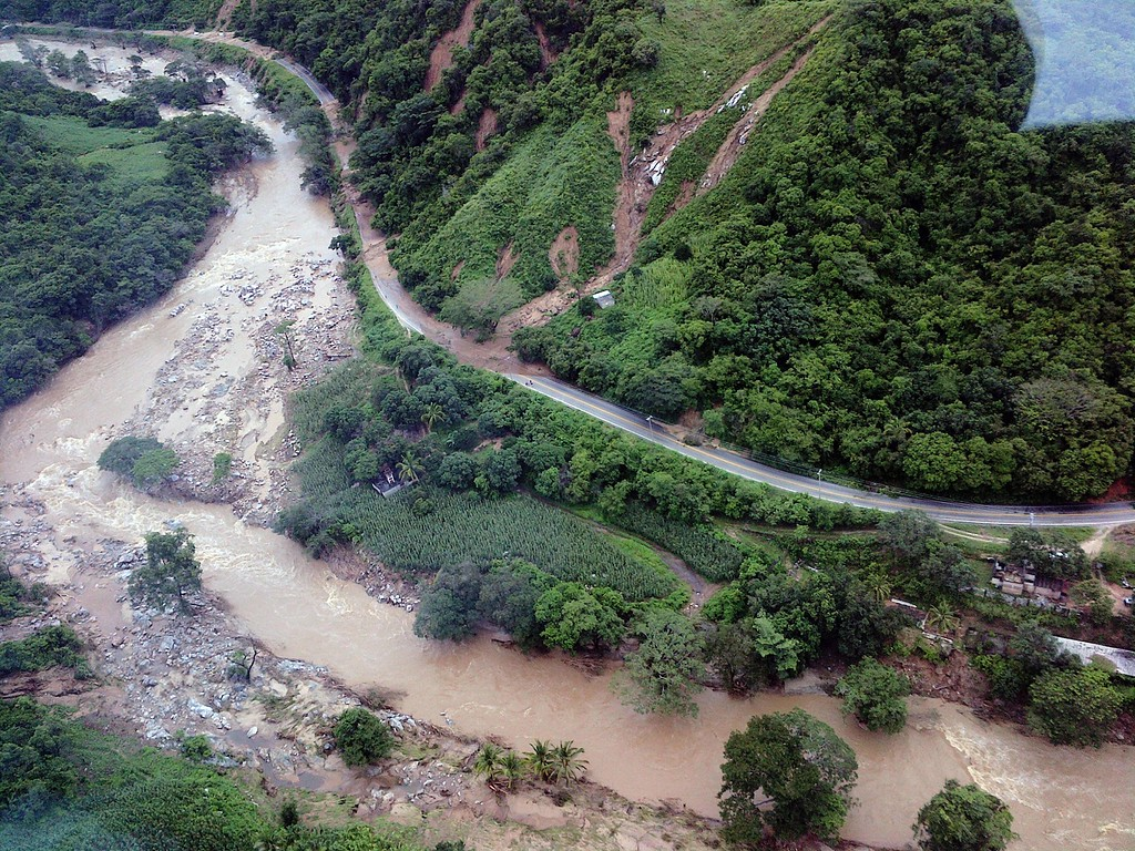 Description of . This handout photo taken and released on September 18, 2013 by Mexico's Interior Ministry press office shows an aerial view of landslides along the highway going to Acapulco, in the Mexican state of Guerrero, as heavy rains hit the country. Resurgent Hurricane Manuel lashed Mexico's northwest coast early on September 19 after twin storms killed at least 80 people nationwide and buried a village under a massive mudslide, leaving dozens more missing. The storms damaged bridges, caused rivers to overflow and flooded half of the Pacific resort of Acapulco, stranding tens of thousands of tourists who sought airlifts while looters ransacked stores.      AFP PHOTO/ Interior MINISTRY /AFP/Getty Images