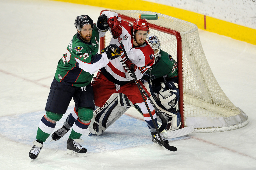 Description of . DENVER, CO - MAY 2: Aaron MacKenzie (37) of the Denver Cutthroats and Jonathan Lessard (91) of the Allen Americans tussle in front of the net during the second period of game 1 of the Ray Miron Presidents Cup Finals at the Denver Coliseum in Denver, Colorado on May 2, 2014. (Photo by Seth McConnell/The Denver Post)
