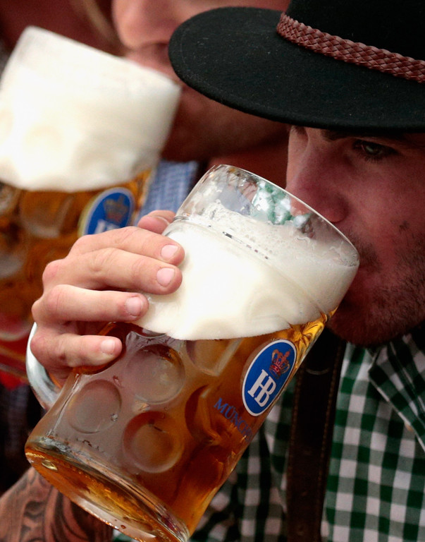 Description of . A young man drinks beer at Hofbraeuhaus beer tent during day 1 of the Oktoberfest 2013 beer festival at Theresienwiese on September 21, 2013 in Munich, Germany. The Munich Oktoberfest, which this year will run from September 21 through October 6, is the world's largest beer fest and draws millions of visitors.  (Photo by Johannes Simon/Getty Images)