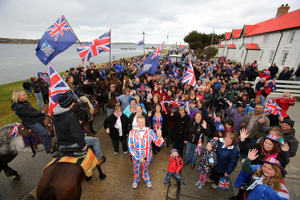 Description of . Residents gather in Stanley, Falkland Islands on March 10, 2013, during a referendum intended to show the world that they want to stay British amid increasingly bellicose claims by Argentina. TONY CHATER/AFP/Getty Images