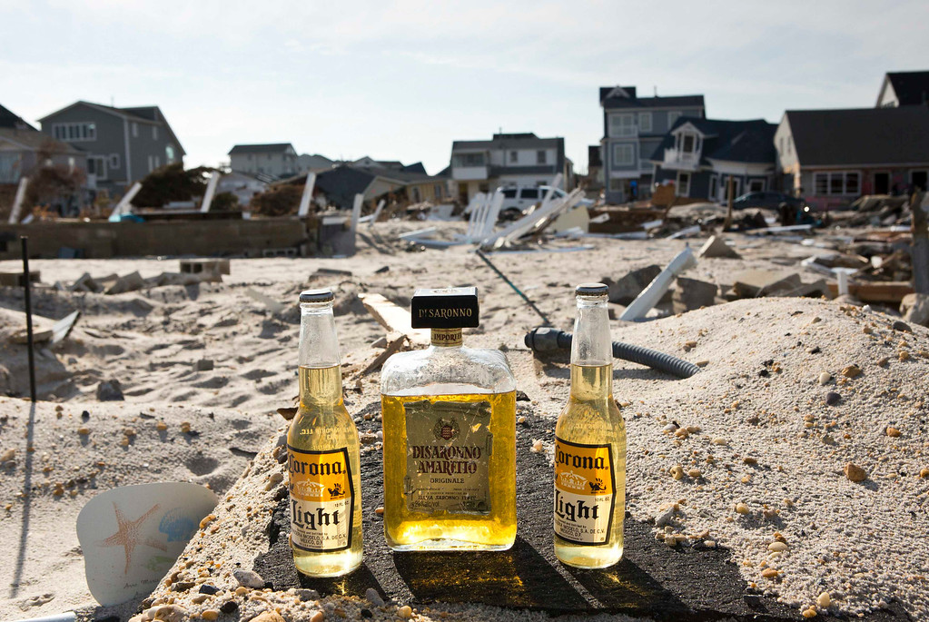 Description of . Bottles of liquor and beer are left on the frame of a home that was destroyed by Hurricane Sandy, in the Ortley Beach area of Toms River, New Jersey November 28, 2012. The storm made landfall along the New Jersey coastline on October 29, 2012 - one month ago tomorrow. REUTERS/Andrew Burton