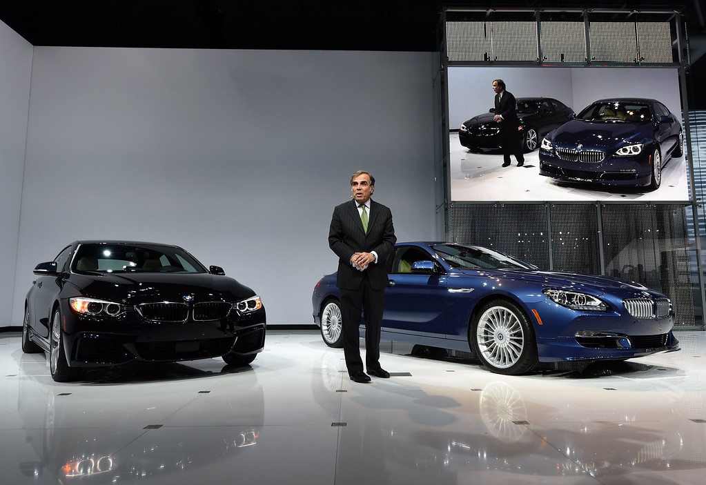 Description of . CEO of BMW North America Ludwig Willisch with the 2015 BMW X4 which was unveiled during the first press preview day at the 2014 New York International Auto Show  April 16, 2014  at the Jacob Javits Center in New York. The auto show is open to the public April 18-27. AFP PHOTO / Timothy A. Clary/AFP/Getty Images