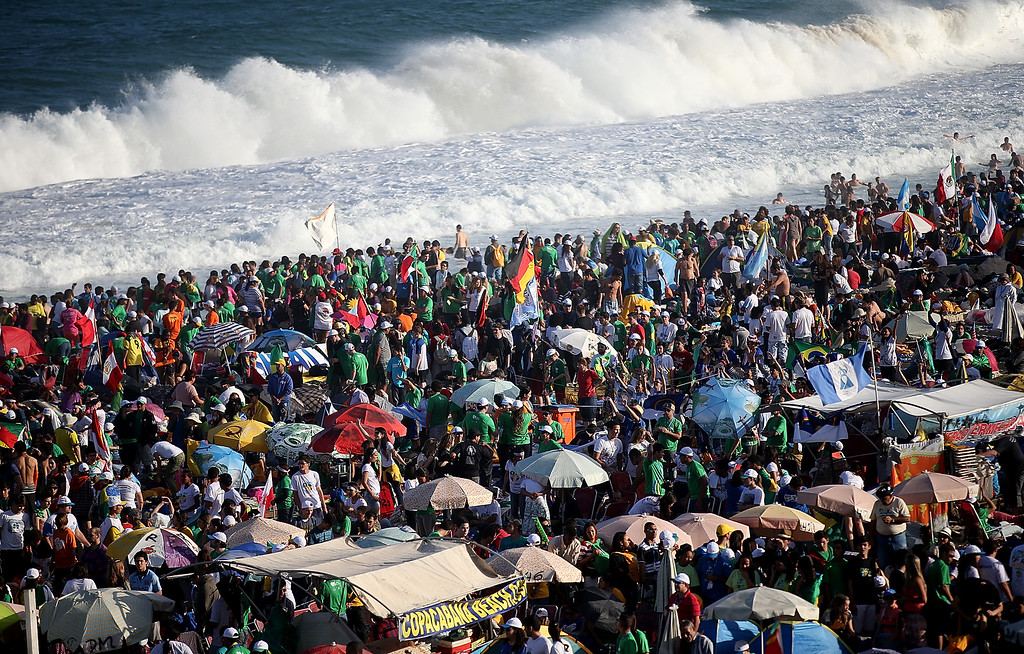 Description of . RIO DE JANEIRO, BRAZIL - JULY 27:  Pilgrims and others jam Copacabana Beach during World Youth Day celebrations where Pope Francis will later attend a prayer vigil with youth on July 27, 2013 in Rio de Janeiro, Brazil. More than 1.5 million pilgrims are expected to join the pontiff for his visit to the Catholic Church's World Youth Day celebrations which runs July 23-28.  (Photo by Mario Tama/Getty Images)