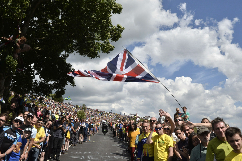 Description of . TOPSHOTS Supporters are pictured along the road during the 201 km second stage of the 101th edition of the Tour de France cycling race on July 6, 2014 between York and Sheffield, northern England.  AFP PHOTO / JEFF PACHOUDJEFF PACHOUD/AFP/Getty Images