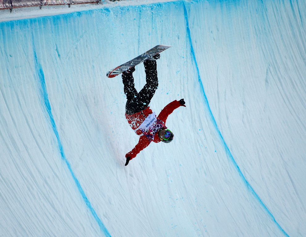 Description of . Poland\'s Michal Ligocki wipes out during qualifying for Men\'s Halfpipe at the Rosa Khutor Extreme Park for the 2014 Winter Olympics in Krasnaya Polyana, Russia, on Tuesday, Feb. 11, 2014.  (Nhat V. Meyer/Bay Area News Group)