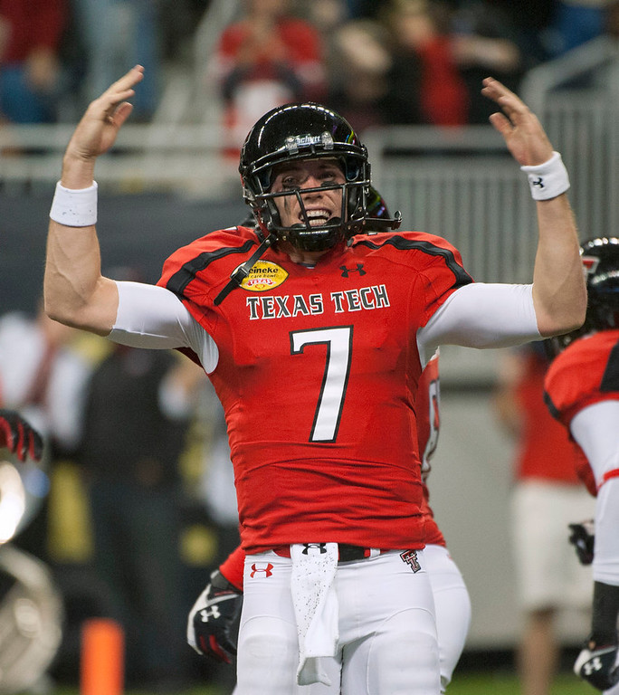 Description of . Texas Tech's Seth Doege gestures after scoring a touchdown against Minnesota during the second quarter of the Meineke Car Care Bowl NCAA college football game, Friday, Dec. 28, 2012, in Houston. (AP Photo/Dave Einsel)