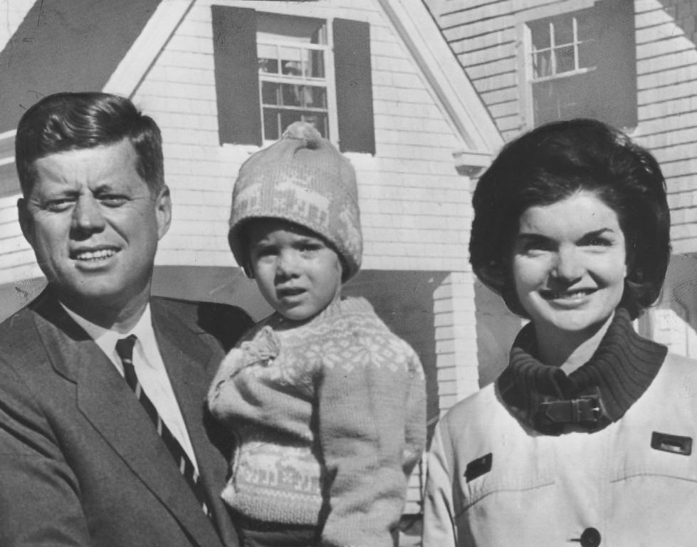 Description of . Kennedy and family outside their Massachusetts home on Nov. 9, 1960. Denver Post file