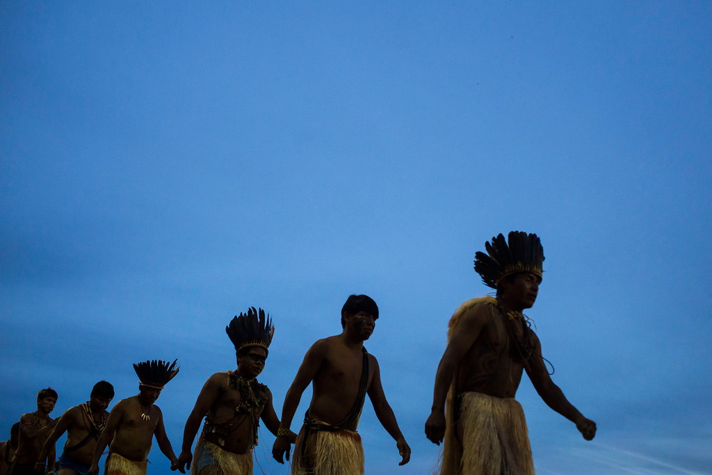 Description of . Indians dance during the indigenous games in Cuiaba, Brazil, Tuesday, Nov. 12, 2013. Around 1,600 Indians from 48 tribes are celebrating Brazil's indigenous cultures during the 12th edition of the Games of the Indigenous People, which runs until Nov. 16. (AP Photo/Felipe Dana)