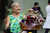 A wheelchair bound elderly woman sells flowers during Valentine's Day at Raffles Place on 14 February, 2013 in Singapore. Valentine's Day is a time to celebrate love, romance and friendship and is celebrated worldwide annually in different ways on February 14. (Photo by Suhaimi Abdullah/Getty Images)