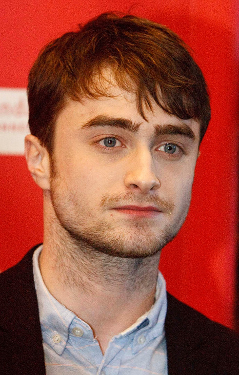 Description of . Daniel Radcliffe poses for pictures before the premiere of