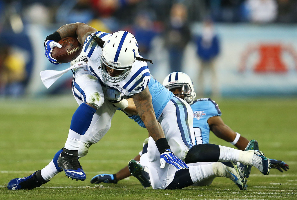 Description of . Trent Richardson #34 of the Indianapolis Colts is tackle by  Colin McCarthy #52 of the Tennessee Titans in the second quarter at LP Field on November 14, 2013 in Nashville, Tennessee.  (Photo by Andy Lyons/Getty Images)