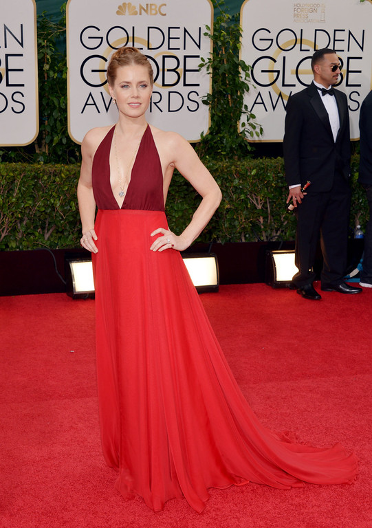 Description of . Amy Adams arrives at the 71st annual Golden Globe Awards at the Beverly Hilton Hotel on Sunday, Jan. 12, 2014, in Beverly Hills, Calif. (Photo by John Shearer/Invision/AP)