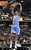 Denver Nuggets forward Danilo Gallinari, of Italy, hangs on the rim after stuffing against the Sacramento Kings during the first quarter of an NBA basketball game in Sacramento, Calif., Sunday, Dec. 16, 2012.(AP Photo/Rich Pedroncelli)