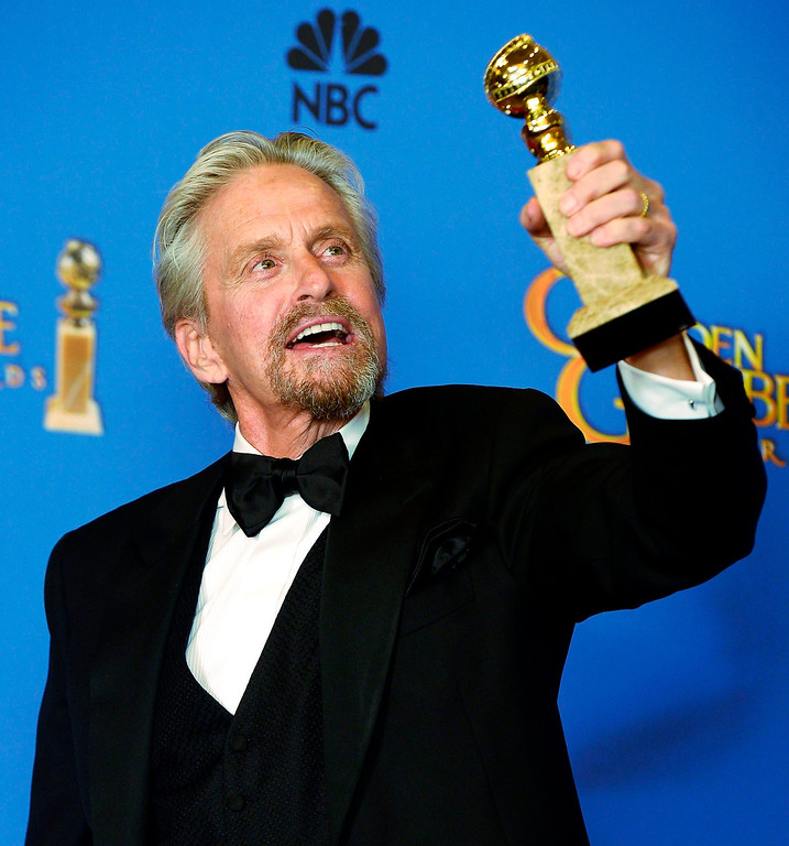 Description of . US actor Michael Douglas holds the Golden Globe for Best Performance by an Actor in a Mini-Series or Motion Picture made for television for \'Behind the Candelabra\' in the press room at the 71st Annual Golden Globe Awards at the Beverly Hilton, in Beverly Hills, California, USA, 12 January 2014.  EPA/PAUL BUCK