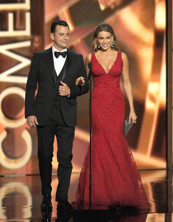 Description of . TV host Jimmy Kimmel and actress Sofia Vergara speak onstage during the 65th Annual Primetime Emmy Awards held at Nokia Theatre L.A. Live on September 22, 2013 in Los Angeles, California.  (Photo by Kevin Winter/Getty Images)