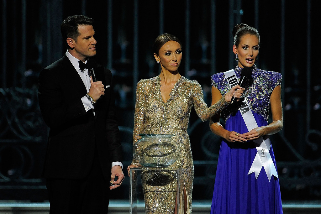 Description of . Hosts Thomas Roberts (L) and Giuliana Rancic (center) speak with Miss Louisiana USA Brittany Alyson Guidry (R) during the 2014 Miss USA Competition at The Baton Rouge River Center on June 8, 2014 in Baton Rouge, Louisiana.  (Photo by Stacy Revere/Getty Images)