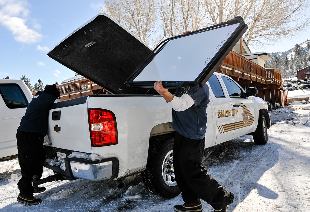 . Inmate workers clear out the command post near Bear Mountain Rersort during day four of the search for fugitive ex-cop Christopher Dorner continues in Big Bear on Sunday, Feb. 10, 2013. Search crews were reduced 25 personnel Sunday. (Rachel Luna / Staff Photographer)
