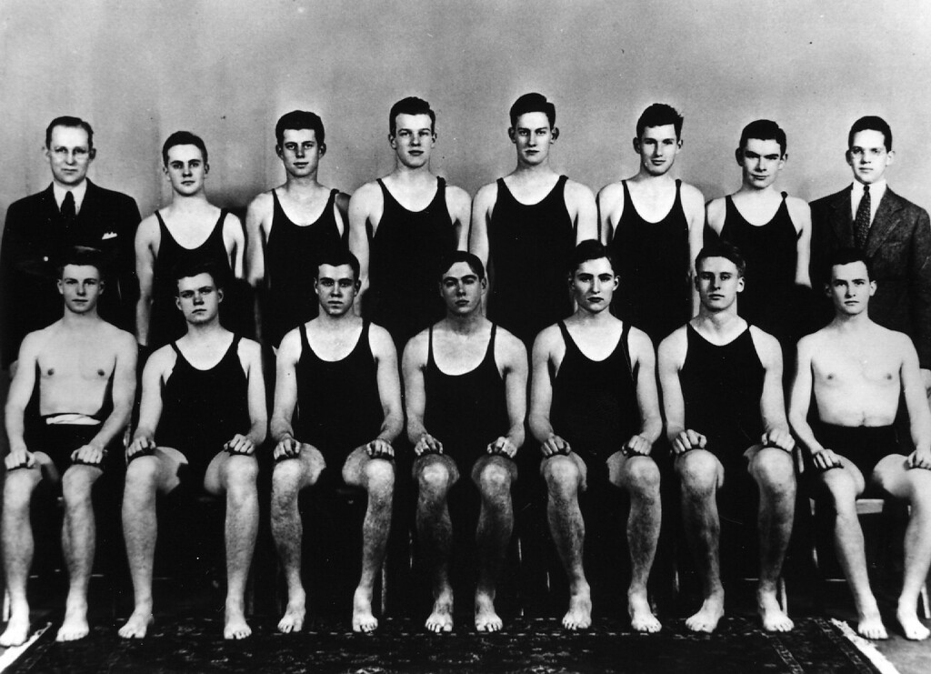 Description of . Kennedy, standing third from left,  was on the Harvard swim team in 1935. Keystone/Getty Images