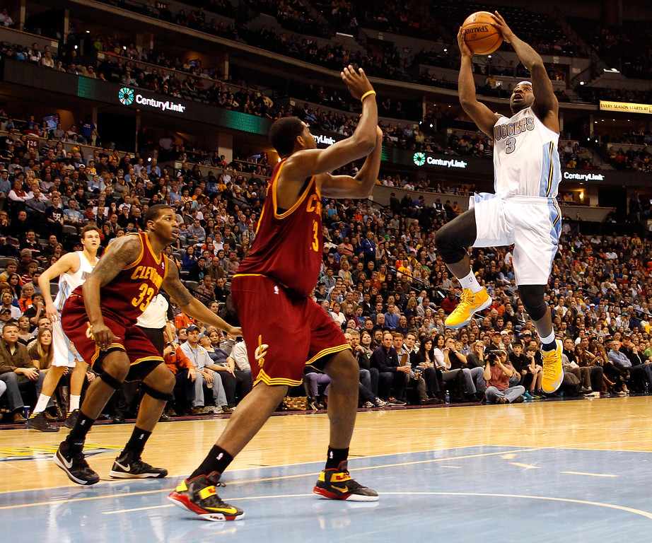 Description of . Ty Lawson #3 of the Denver Nuggets drives for a shot attempt in the second half against Tristan Thompson #13 of the Cleveland Cavaliers at Pepsi Center on January 11, 2013 in Denver, Colorado. (Photo by Chris Chambers/Getty Images)