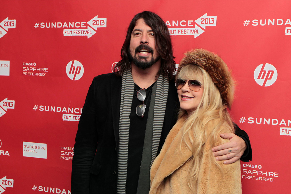 Description of . Musicians Dave Grohl (L) and Stevie Nicks arrive for the premiere of the documentary