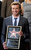 Australian actor Simon Baker holds a replica of his new star on the Hollywood Walk of Fame, on Thursday, Feb. 14, 2013 in Los Angeles. (Photo by Chris Pizzello/Invision/AP)