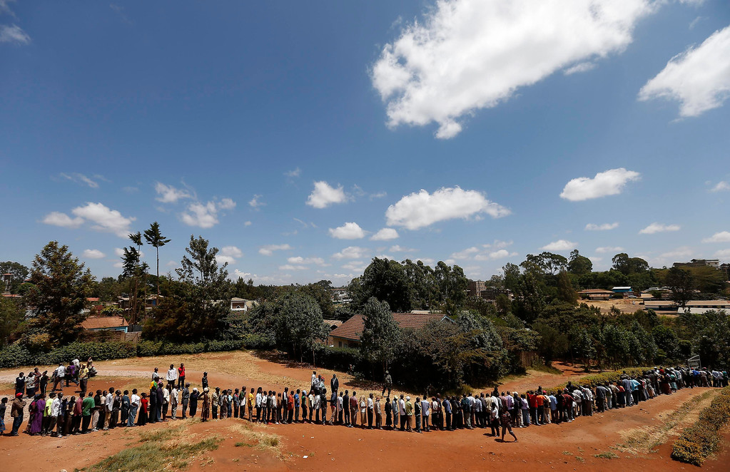 Description of . Kenyans wait in line to cast their votes in the Kibera slum in the capital Nairobi March 4, 2013. Polling stations opened up to Kenyans on Monday for a tense presidential election that will test whether the east African nation can repair its damaged reputation after the tribal blood-letting that followed a 2007 poll. REUTERS/Steve Crisp