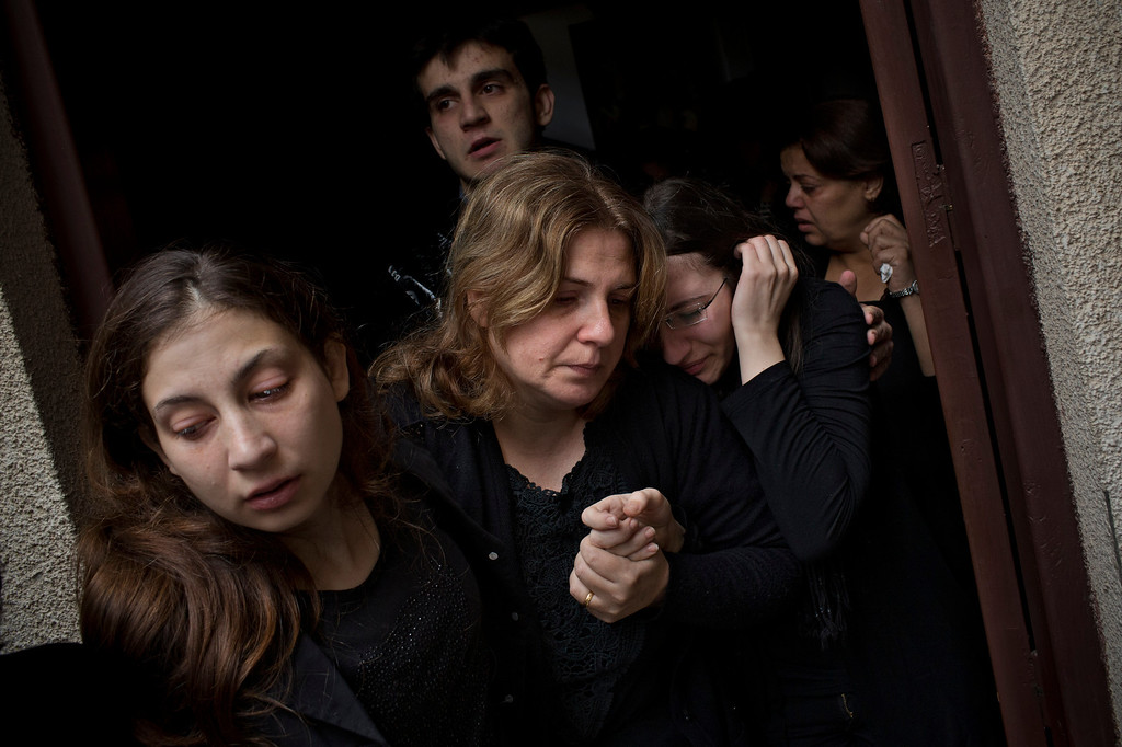 Description of . In this Nov. 20, 2012 file photo, Palestinian mourners cry during the funeral of Salem Paul Sweliem during his funeral in Gaza City. This photo was one in a series of images by Associated Press photographer Bernat Armangue that won the first place prize in the World Press Photo 2013 photo contest for the Spot News series category.   (AP Photo/Bernat Armangue, File)