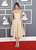 Alexa Chung arrives at the 55th annual Grammy Awards on Sunday, Feb. 10, 2013, in Los Angeles.  (Photo by Jordan Strauss/Invision/AP)