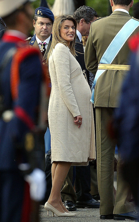 Description of . This picture taken 12 October 2005 shows Spain's Princess Letizia (C) arriving with her husband Prince Felipe for the national day army parade in Madrid.  Princess Letizia, the eight-and-a-half-months pregnant wife of Spanish heir to the throne Prince Felipe de Bourbon, was admitted to a private maternity clinic 30 October 2005 on medical advice, the royal palace announced. JAVIER SORIANO/AFP/Getty Images)