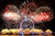 Fireworks explode over the London Eye in central London, as part of the New Year celebrations Tuesday, Jan. 1, 2013. (AP Photo/PA, Dominic Lipinski)