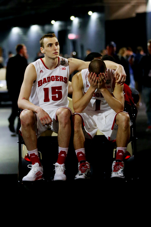 Description of . ARLINGTON, TX - APRIL 05:  Sam Dekker #15 and Ben Brust #1 of the Wisconsin Badgers react after losing to the Kentucky Wildcats 74-73 in the NCAA Men's Final Four Semifinal at AT&T Stadium on April 5, 2014 in Arlington, Texas.  (Photo by Ronald Martinez/Getty Images)