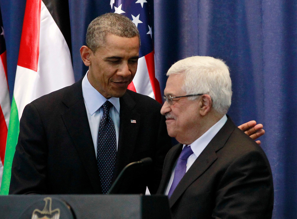 Description of . U.S. President Barack Obama participates in a joint news conference with Palestinian President Mahmoud Abbas at the Muqata Presidential Compound in Ramallah, March 21, 2013.   REUTERS/Jason Reed