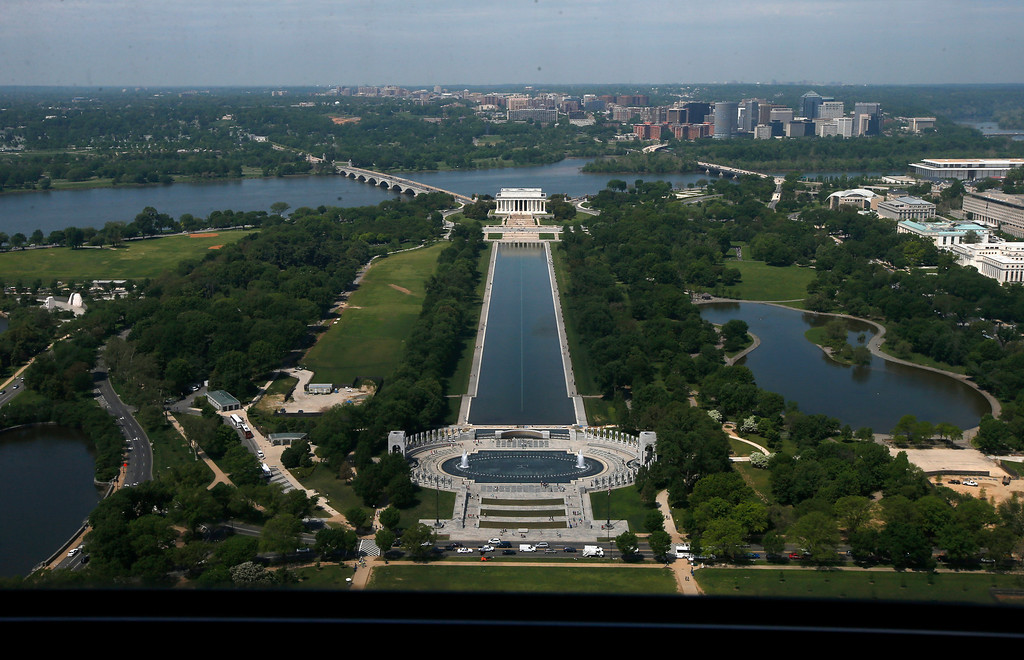. The Lincoln Memorial, rear, and the National World War II Memorial are seen from the 500-foot level of the Washington Monument in Washington, Monday, May 12, 2014, after a ceremony celebrated its re-opening.  (AP Photo)