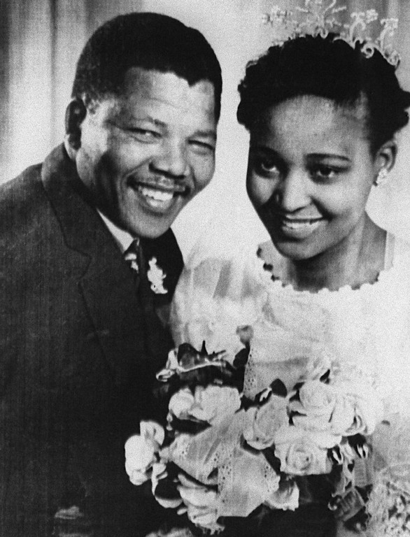 Description of . South African anti-apartheid leader and member of the African National Congress (ANC) Nelson Mandela shown in a file photo dated 1957 posing with his wife Winnie during their wedding. (Photo credit should read OFF/AFP/Getty Images)