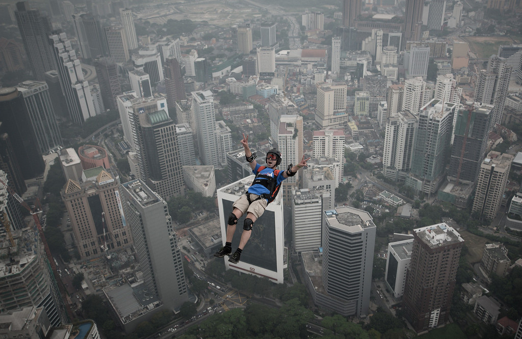 Description of . Base jumper Olivier Julien Chacornac from France leaps from the 300-meters Open Deck of the Malaysia's landmark Kuala Lumpur Tower during the International Tower Jump in Kuala Lumpur on September 27, 2013.  AFP PHOTO / MOHD RASFAN/AFP/Getty Images