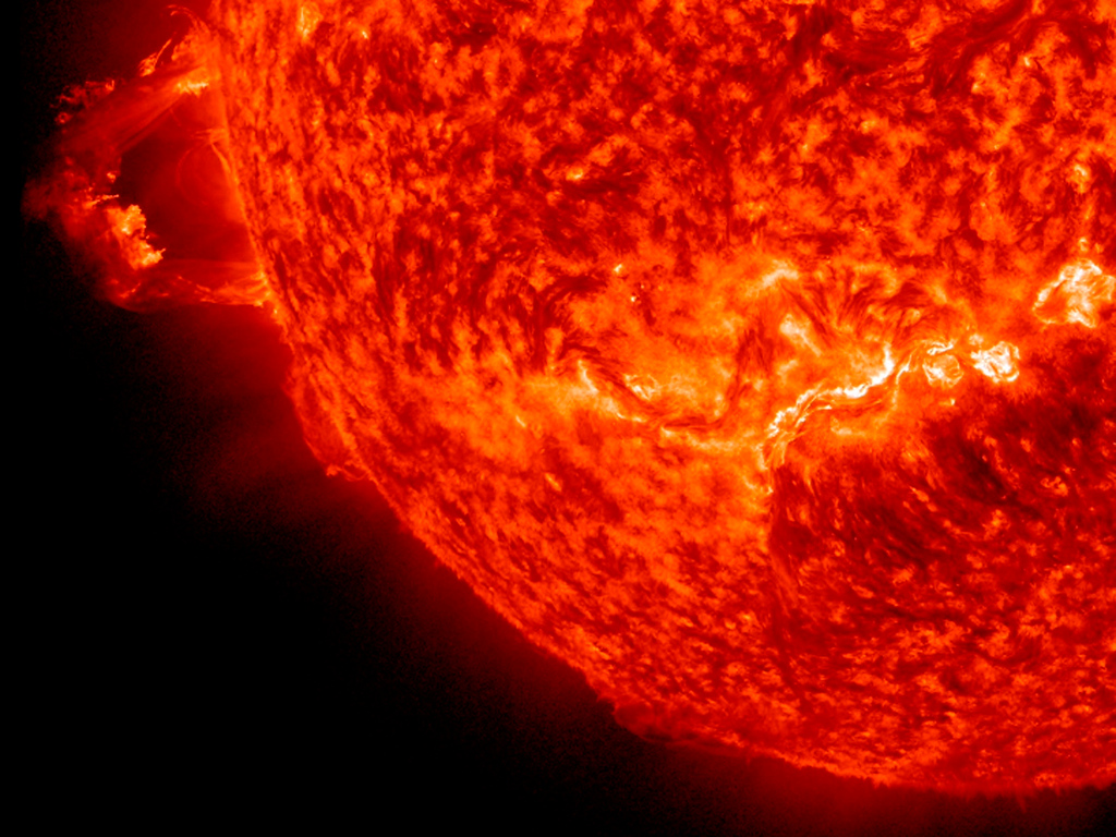 . The Sun erupted with two prominence eruptions, one after the other over a four-hour period, as pictured in this NASA handout photo taken on November 16, 2012. The action was captured in the 304 Angstrom wavelength of extreme ultraviolet light. It seems possible that the disruption to the Sunís magnetic field might have triggered the second event since they were in relatively close proximity to each other. The expanding particle clouds heading into space do not appear to be Earth-directed. REUTERS/NASA/SDO/Steele Hill/Handout