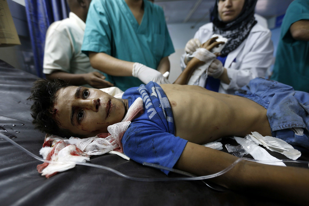 Description of . A wounded boy from the Bakr family, receives treatment at al-Shifa hospital, in Gaza City, on July 16, 2014. Four children were killed and several injured at a beach in Gaza City medics said, in Israeli shelling witnessed by AFP journalists. The strikes appeared to be the result of shelling by the Israeli navy against an area with small shacks used by fishermen. The deaths raised the overall toll in nine days of violence in Gaza to 213. AFP PHOTO/MOHAMMED ABED/AFP/Getty Images