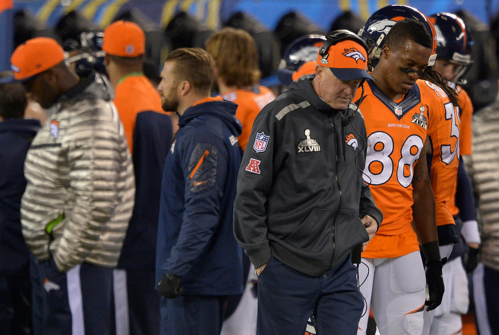 Description of . Denver Broncos head coach John Fox and Denver Broncos wide receiver Demaryius Thomas (88) during the second quarter. The Denver Broncos vs the Seattle Seahawks in Super Bowl XLVIII at MetLife Stadium in East Rutherford, New Jersey Sunday, February 2, 2014. (Photo by John Leyba/The Denver Post)