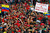 Supporters of Venezuela's late President Hugo Chavez wait for a chance to view his body in state at the military academy in Caracas March 8, 2013. REUTERS/Carlos Garcia Rawlins