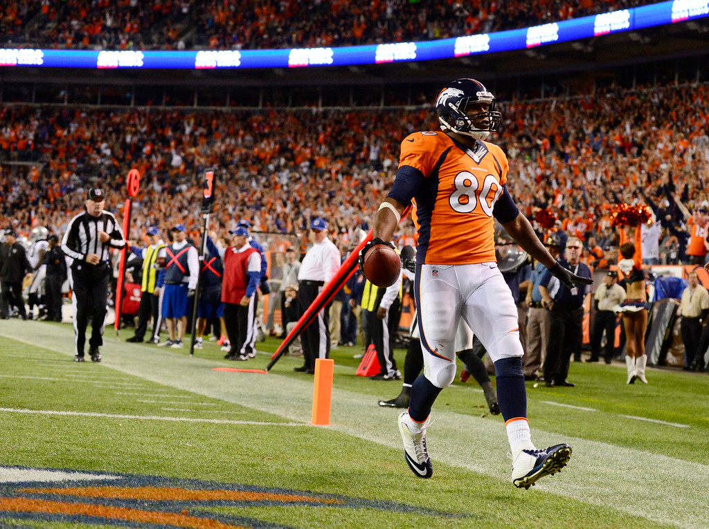 . Denver Broncos tight end Julius Thomas (80) scores a touchdown in the second quarter. The Denver Broncos took on the Oakland Raiders at Sports Authority Field at Mile High in Denver on September 23, 2013. (Photo by AAron Ontiveroz/The Denver Post)