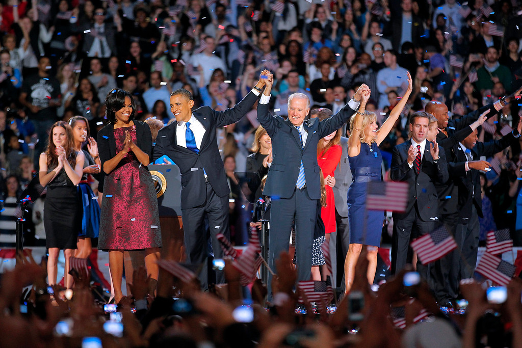 Description of . In this Nov. 7, 2012 file photo, President Barack Obama and wife Michelle holds hands with Vice President Joe Biden and his wife Jill following Obama's victory speech to supporters in Chicago. (AP Photo/Jerome Delay, File)