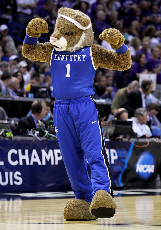 Description of . The Kentucky Wildcats mascot performs during the second round of the 2014 NCAA Men's Basketball Tournament against the Kansas State Wildcats at the Scottrade Center on March 21, 2014 in St Louis, Missouri.  (Photo by Andy Lyons/Getty Images)